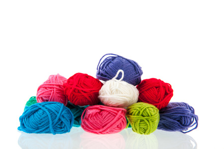 craftwork: Many balls of colorful wool isolated over white background Stock Photo