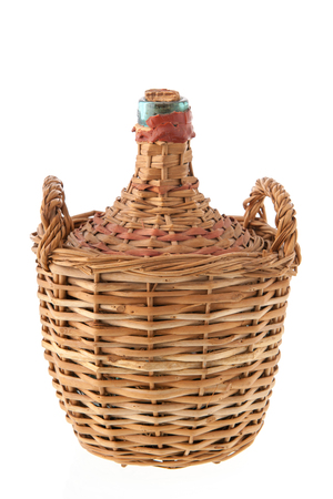 carboy: Carboy bottle with glass in wicker isolated over white background