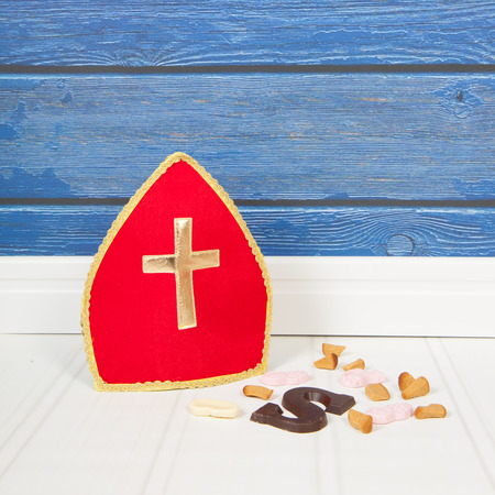 mitre: Dutch Sinterklaas candy and mitre on blue background