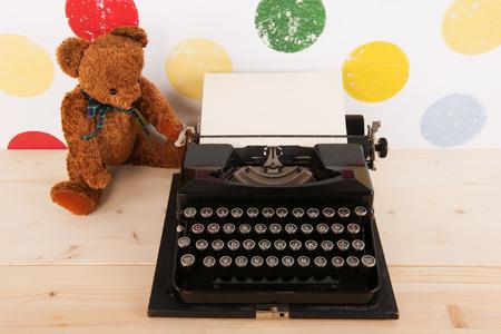 typewriter: vintage bear and old black typewriter with blank paper