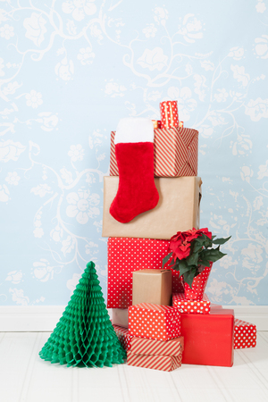 wall paper: Christmas gifts in interior with blue wall paper