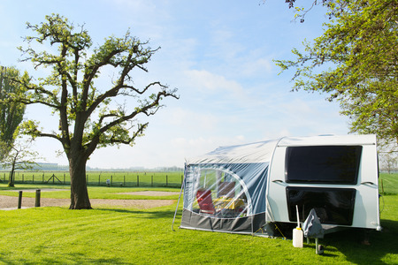 caravan: Campground with caravan in spring Stock Photo