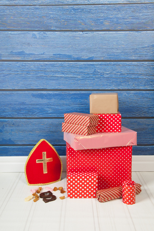 pepernoot: Dutch Sinterklaas gifts and candy on blue background