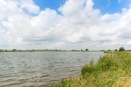 dutch: Dutch river Nederrijn with clouds