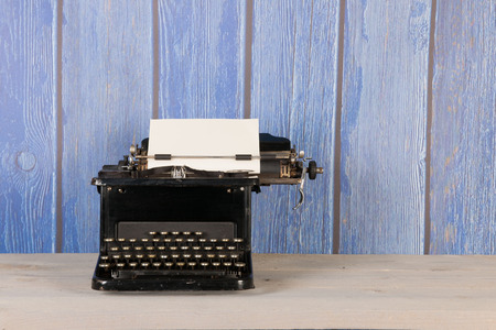 Antique black typewriter in interior Stock Photo