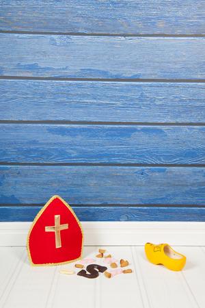 sinterklaas: Dutch Sinterklaas candy and mitre on blue background