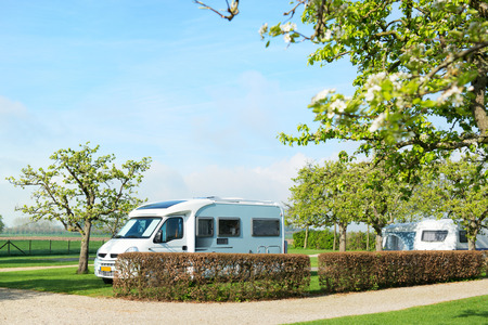 campground: Campground with mobile home and caravan in spring