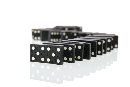 double game: Row domino cards isolated over white background