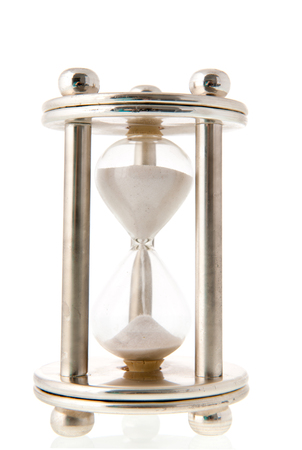trickling: hourglass with sand isolated over white background