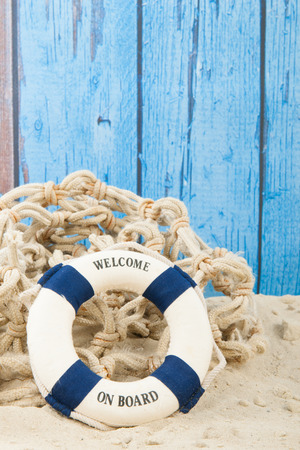 beach buoy: Life buoy with welcome at the beach Stock Photo
