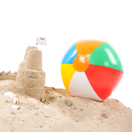 sandcastle: Beach with sandcastle and toys isolated over white background