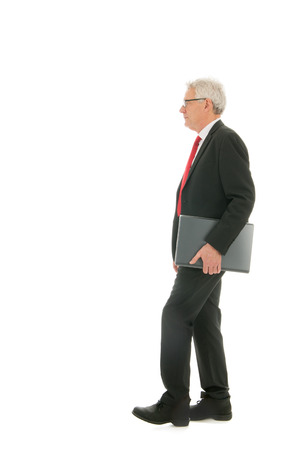 formally: Formally dressed Senior business man with laptop