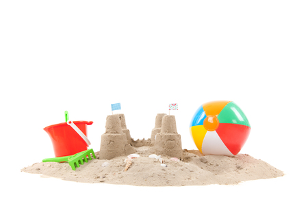 in the sand: Beach with sandcastle and toys isolated over white background