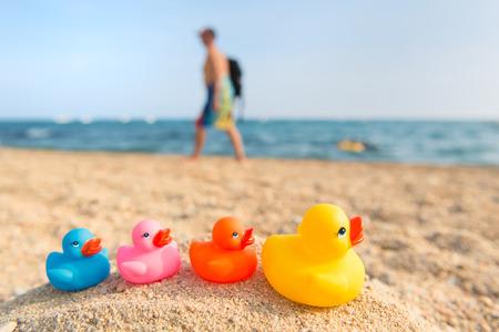 beack: Row colorful ducks at the summer beach Stock Photo