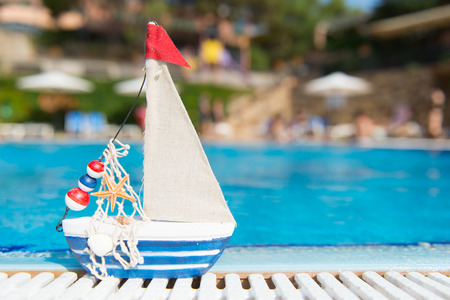 accomodation: Miniature boat as toy at the swimming pool