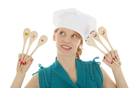 toque: Woman cooking with funny wooden spoons and toque hat Stock Photo
