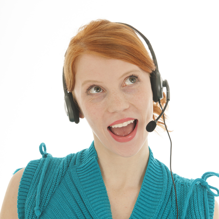 red haired woman: Young red haired woman with head set for call center looking surprised