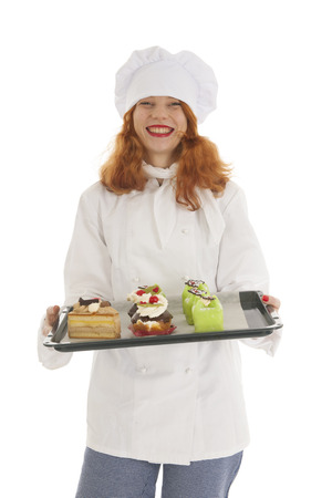 christmas baker's: Female baker chef with red hair baked Christmas pastries isolated over white background