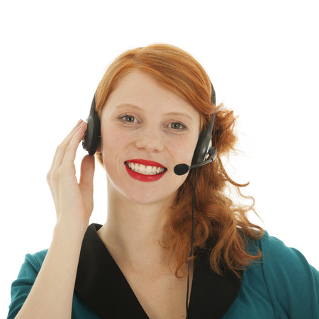 red haired woman: Young red haired woman with head set for call center Stock Photo