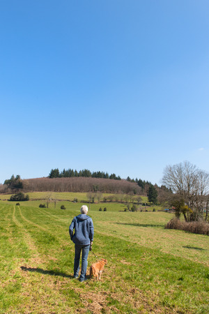 ze: Man with dog in landscape French Limousin