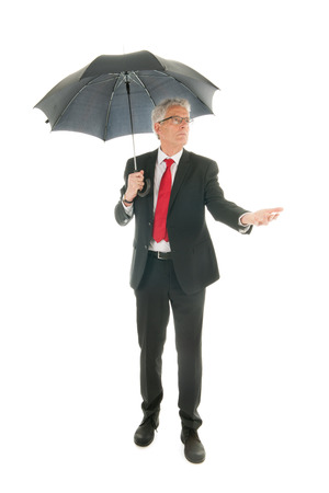 formally: Formally dressed Senior business man with umbrella