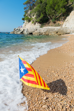 catalunya: Catalan flag at beach in Catalunya