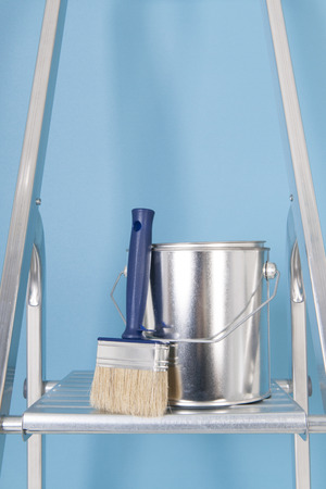 stepladder: Painting the interior with tins and brushes on stepladder