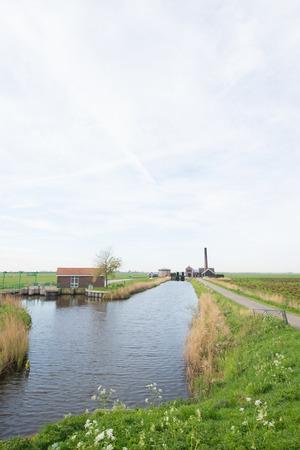 polder: Dutch pumping station in polder landscape