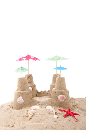 sandcastle: Beach with sandcastle and parasols Stock Photo