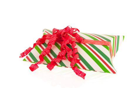 wrapped gift: Wrapped gift in green and red isolated over white background