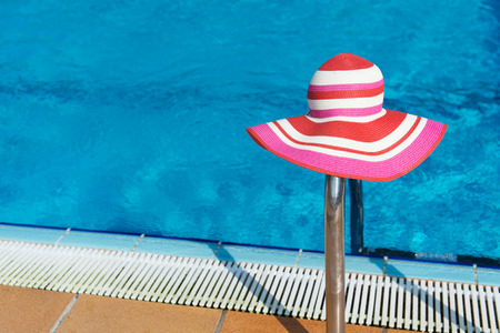 sunhat: Luxury swimming pool with pink female sun hat