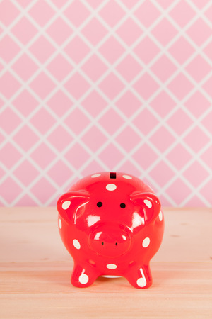 bank interior: Funny red piggy bank in pink interior