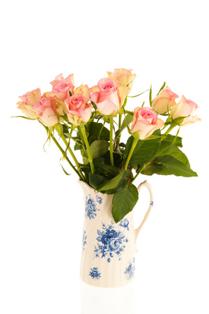 dutch typical: Bouquet pink roses in typical Dutch vase isolated over white background
