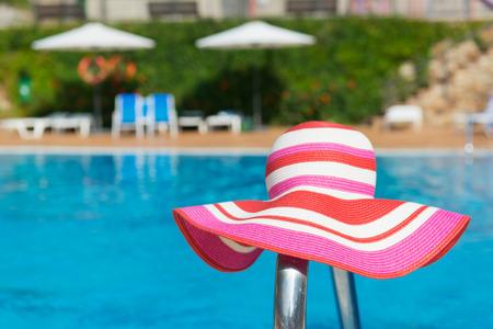 sun hat: Luxury swimming pool with pink female sun hat