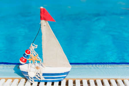 Miniature boat as toy at the swimming pool