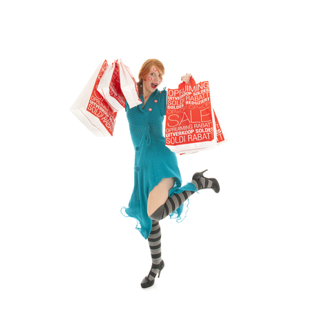 excitation: Woman jumping with shopping bags during season sale Stock Photo