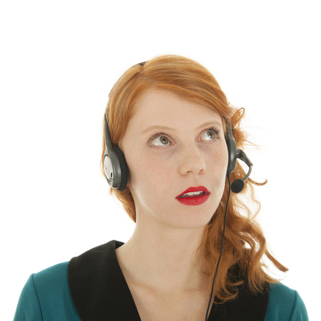 haired: Young red haired woman with head set for call center Stock Photo