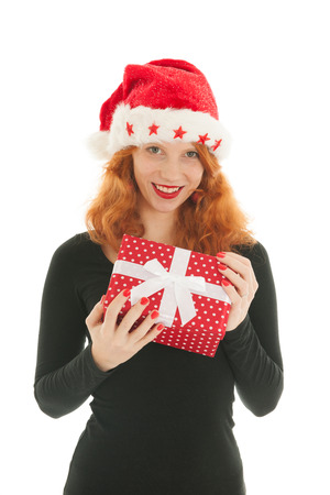 haired: Young red haired woman with Christmas gift Stock Photo