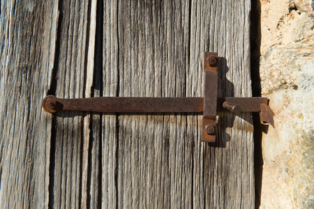 door handle: Rusty door handle on barn wood