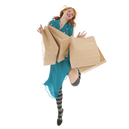 Woman jumping during season sale with bags