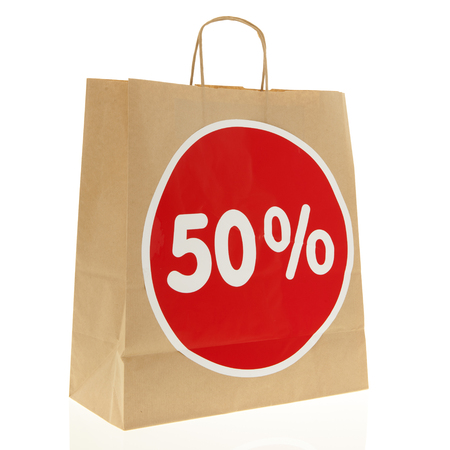 nformation: Brown paper shopping bag with 50% discount isolated over white background
