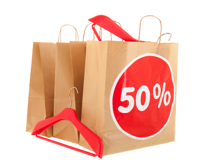 nformation: Brown paper shopping bags with 50% discount and  isolated over white background Stock Photo