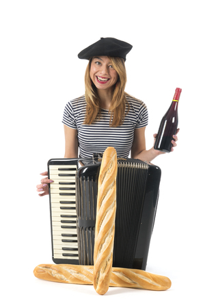 French girl making music with accordion instrument, bread and wine isolated over white background