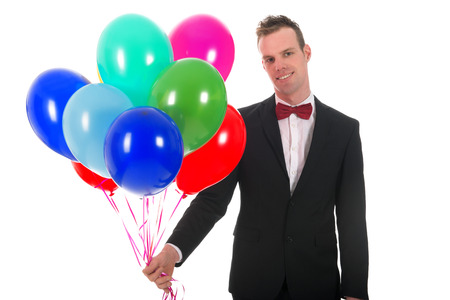 blowed: Young man with a bunch of colorful balloons isolated over white background