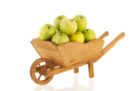Wheelbarrow full with green fresh apples Stok Fotoğraf