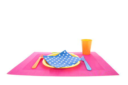 Set table with place mat, plate and cutlery