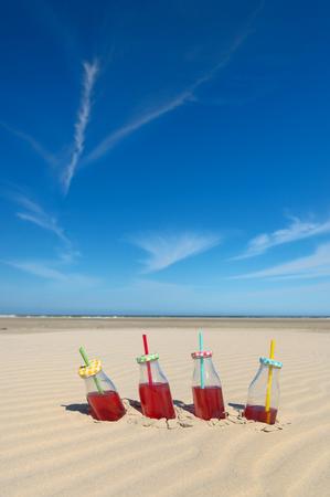 Bottles lemonade at the empty beach