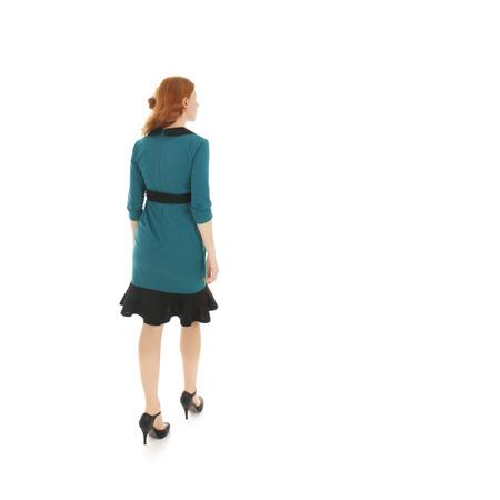 cuerpo entero: pretty woman formal dressed walking in studio isolated over white background Foto de archivo