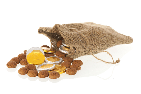 Bag with Dutch ginger nuts and chocolate coins for typical Sinterklaas holidays