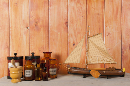 Several pharmacy objects in interior with wooden background